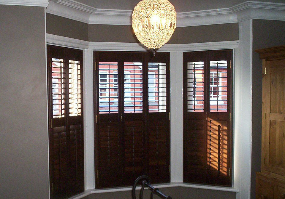 Browse our customers diy shutters from diy shutters uk diy shutters dark stained shutters for bay window solutioingenieria