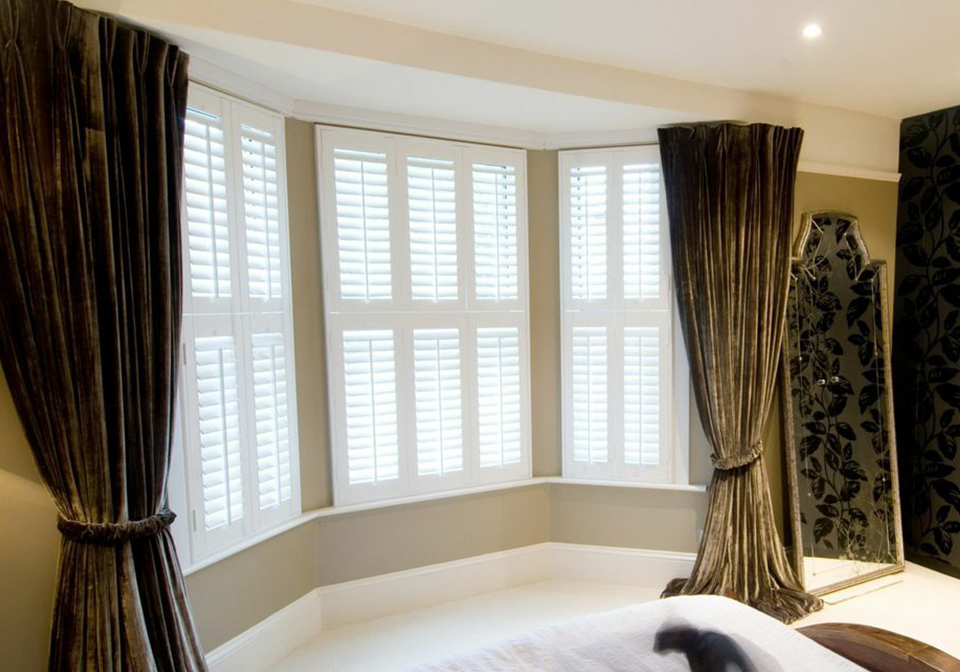 Poplar wood, bright white shutters fitted in a 3 section bay