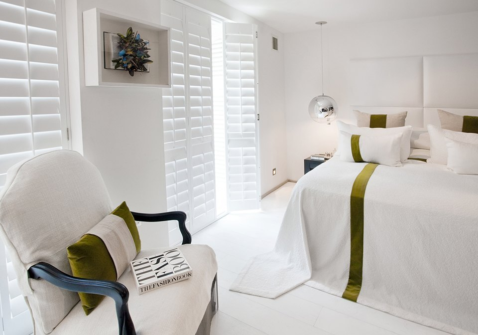 Extra White Designer shutters in a modern bedroom.