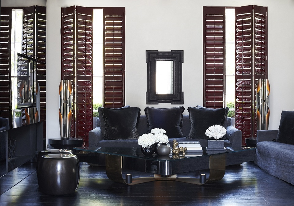 Claret red coloured full height shutters in a lounge