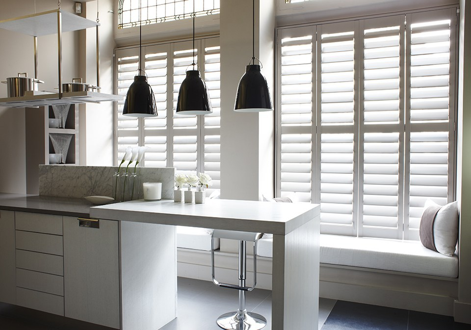 Plaster coloured Designer shutters in a modern kitchen