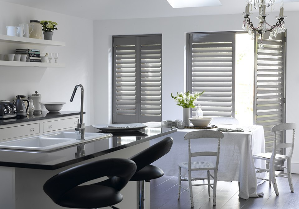 Tuscan grey full height shutters in a kitchen/dining room